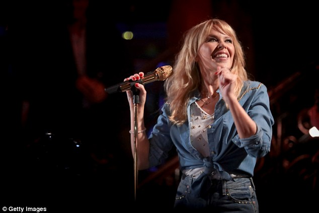 Spotlight split! 'It was too much and they weren't very good songs. I don't mind that, because it's out of my system. Once it was done, things got easier,' the Australian icon explained of her split with British actorJoshua