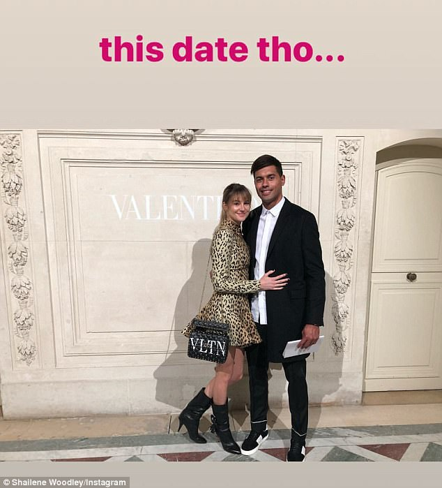 Date night: The public display of affection didn't stop there as the brunette beauty went on to share a photo of her cuddling up to the Bordeaux Bègles player