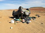 A pair of British backpackers cheated death after their car (pictured) overturned in the Australian outback last week