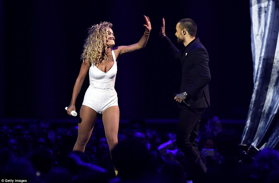 High five! After belting out the concluding notes of their sultry track, a smiling Rita raised her hand to high-five a happy Liam