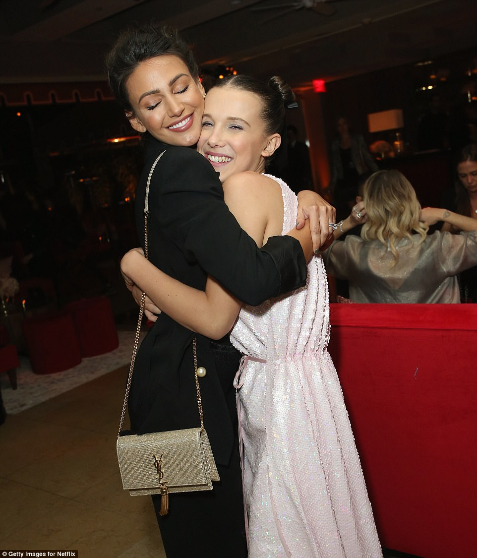Strange! Michelle Keegan (left) was seen mingling with Netflix breakout star Millie Bobby Brown (right) on Sunday night, as she the streaming service held a party to celebrate the Screen Actors Guild Awards in Hollywood
