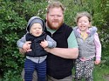 Simon Gilby, 36, from Exmouth, Devon, died after falling ill while on a flight from Christchurch to Dubai on Sunday. he is pictured with his children, Chloe, four, and two-year-old Angus