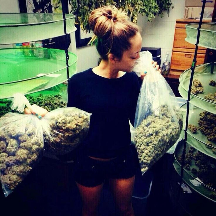 Mrs. Nugz holding some of the newest high quality weed grown at one of her three marijuana dispensaries