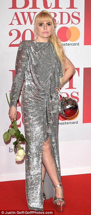 All that glitters is... silver:Paloma matched the dress with silver heels, all complimented by the bells in her hair and the glitter ball she swung by her side