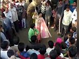 Shocking footage shows a wife being flogged 100 times by her husband as punishment for adultery before collapsing in front of a mob