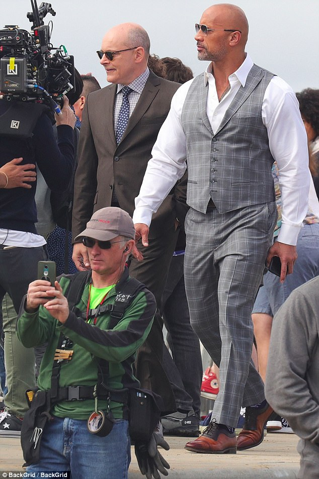 Lights,camera, action: Dwayne was also spotted alongside co-star Rob Corddry in an equally sophisticated brown suit