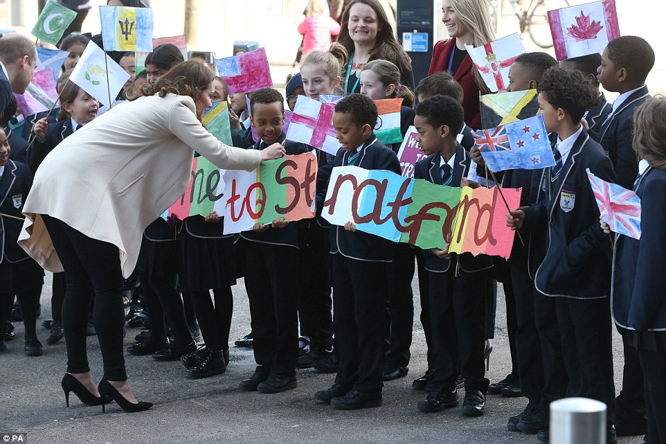 The Duchess was impressed the school children's artwork as she examined their hand painted sign welcoming her to East London