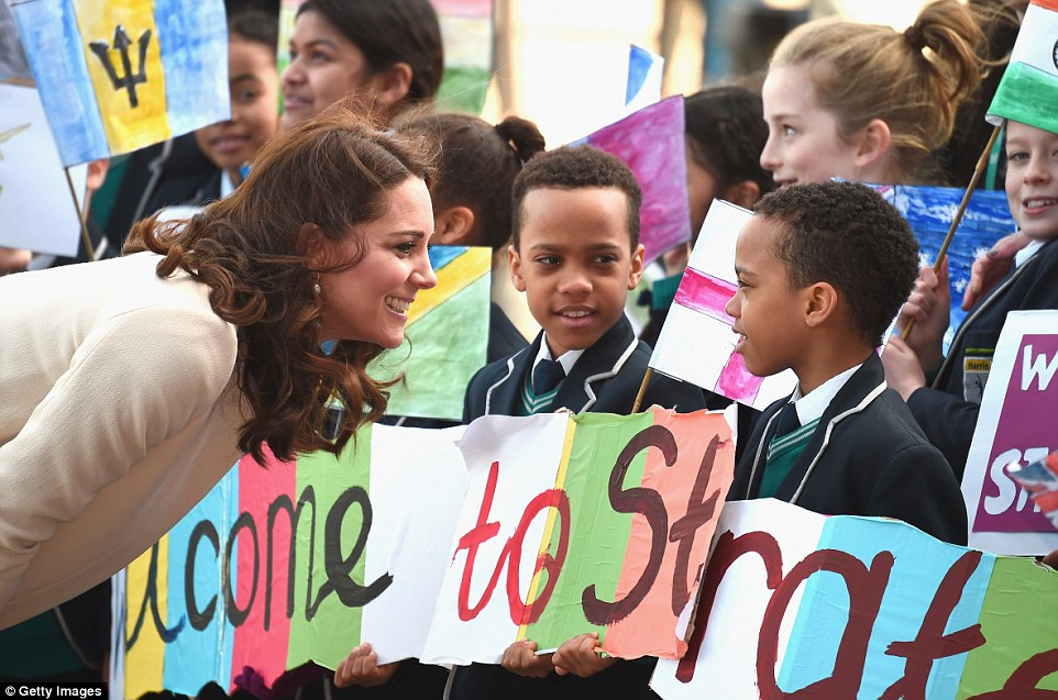 Pregnant Kate paused to boys from Chobham Academy who took pride of place in the front row