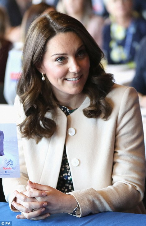 The Duchess of Cambridge looked elegant in a cream coat by Goat for her visit to East London today
