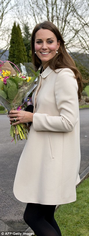 Kate on a visit to Child Bereavement UK in March 2013 while pregnant with Prince George
