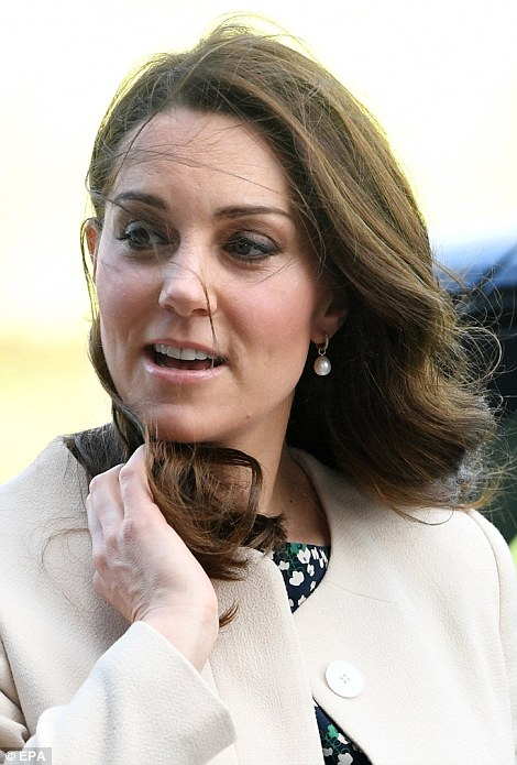 Pregnant Kate was looking a little windswept