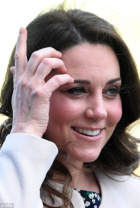 The Duchess brushed her brunette locks out of her face