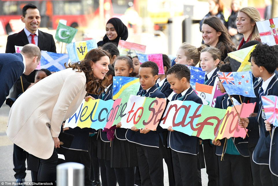 The Duchess paused to examine the artwork created by young school children for the royal visit