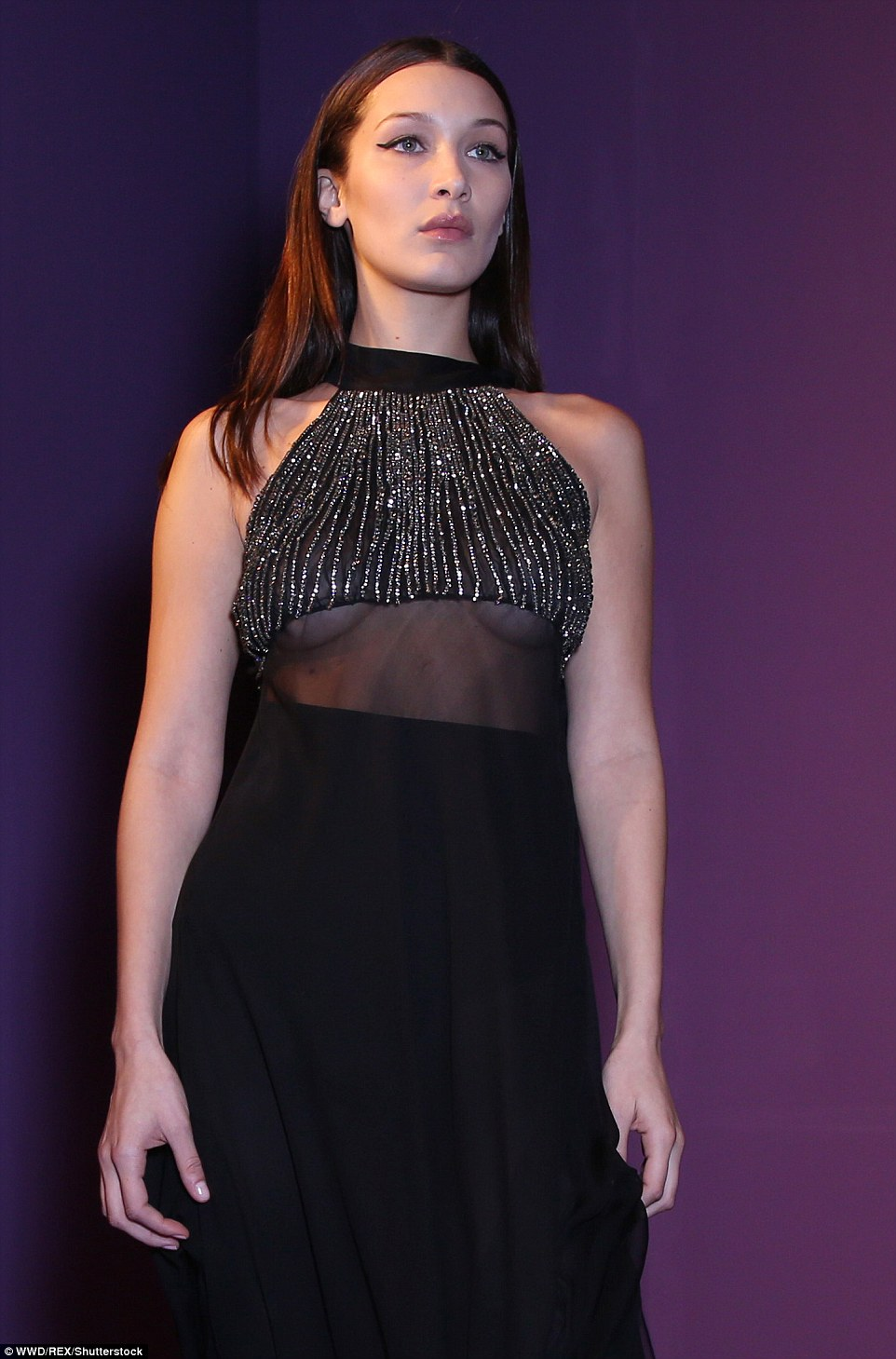 On display: Bella's striking halterneck fully exposed her nicely toned arms