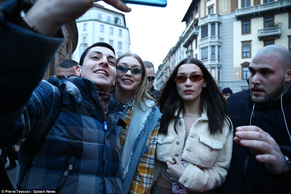 Say cheese: Gigi and Bella posed for selfies with fans outside the event on Wednesday afternoon