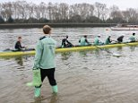Pictured: Members of Cambridge University's boat club braved chilly temperatures for a practice on the River Thames earlier this morning before the race against Oxford