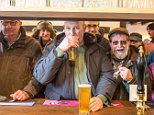 These punters enjoyed a pint at the Packhorse Inn when it reopened its doors today after being bought back by locals in the area