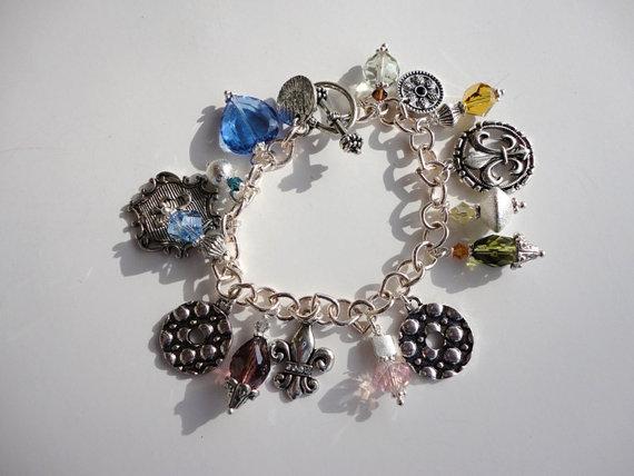 charm bracelet. silver bracelet. crystal bracelet. handmade bracelet. fleur de lis bracelet.