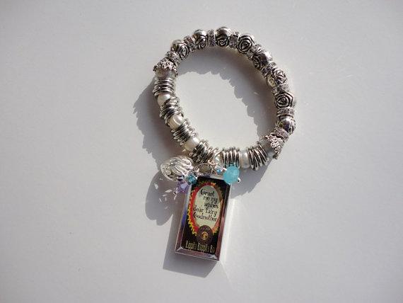 charm bracelet. strech bracelet. silver plated bracelet. pearl bracelet. beaded bracelet.