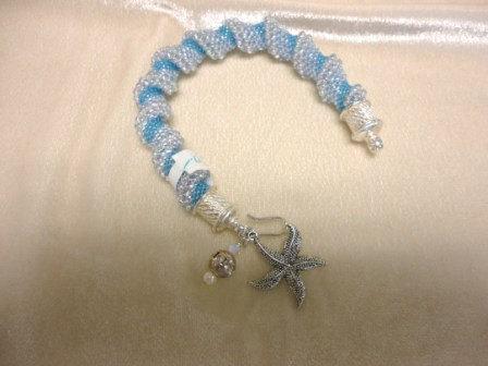 beadwork bracelet. silver charm bracelet. woven bracelet . seed bead bracelet. spiral bracelet. woven jewelry