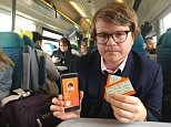 Unchallenged: Reporter Simon Murphy with his newly issued 16-25 Railcard and discounted tickets, despite being 29 years old