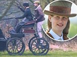 Lady Louise Windsor (pictured alongside a man thought to be a groom) enjoyed a carriage ride around Windsor Castle today