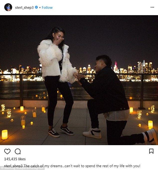 The big proposal: Here the athlete is seen getting down on one knee on a roof top