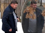 Australian billionaire James Packer seen taiing a step outside in the cold to have a smoke break during his time at the psychiatric hospital where he checked into in Boston
