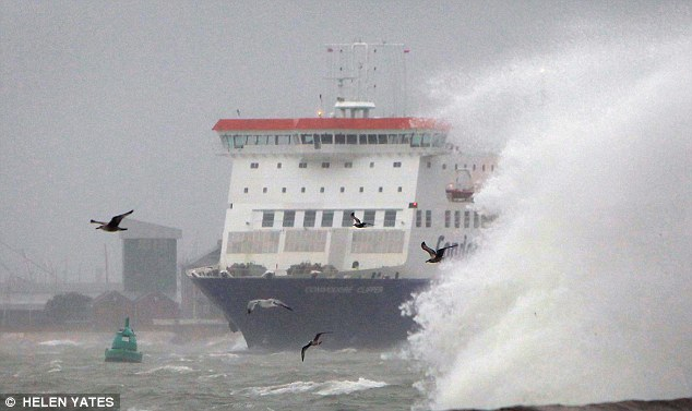 A ferry crosses the Solent near Southsea sea front in Hampshire. Energy firms reaped huge profits from their wind farms during the recent storms while families suffered Christmas blackouts