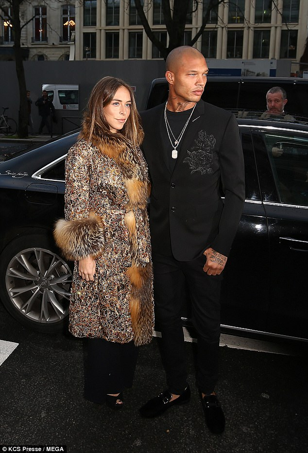 Dashing: Her sharply dressed model boyfriend Jeremy didn't disappoint with his high-fashion wardrobe choices, rocking a smooth black suit jacket, embellished with rose needle-work on the chest