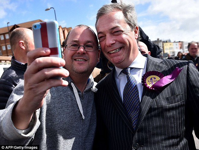 Mr Farage - posing for a selfie with a supporter on the final day of the election campaign - is trying to turn round an 8,000 vote Tory majority