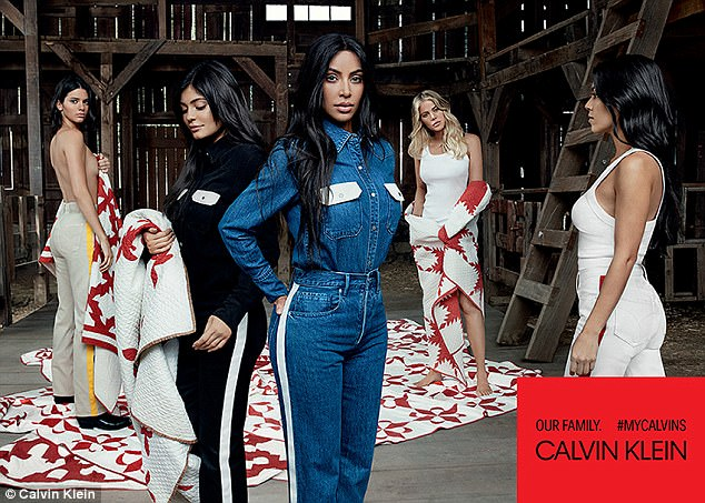 Mum's the word! Kylie Jenner strategically hides her baby bump as she makes a brief return to the spotlight to pose alongside her sisters for #MyCalvins campaign
