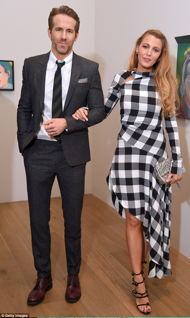 Not letting go: The photogenic couple stayed arm-in-arm at the Guggenheim gallery venue