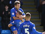 Gillingham's Doug Loft (top) is congratulated after scoring