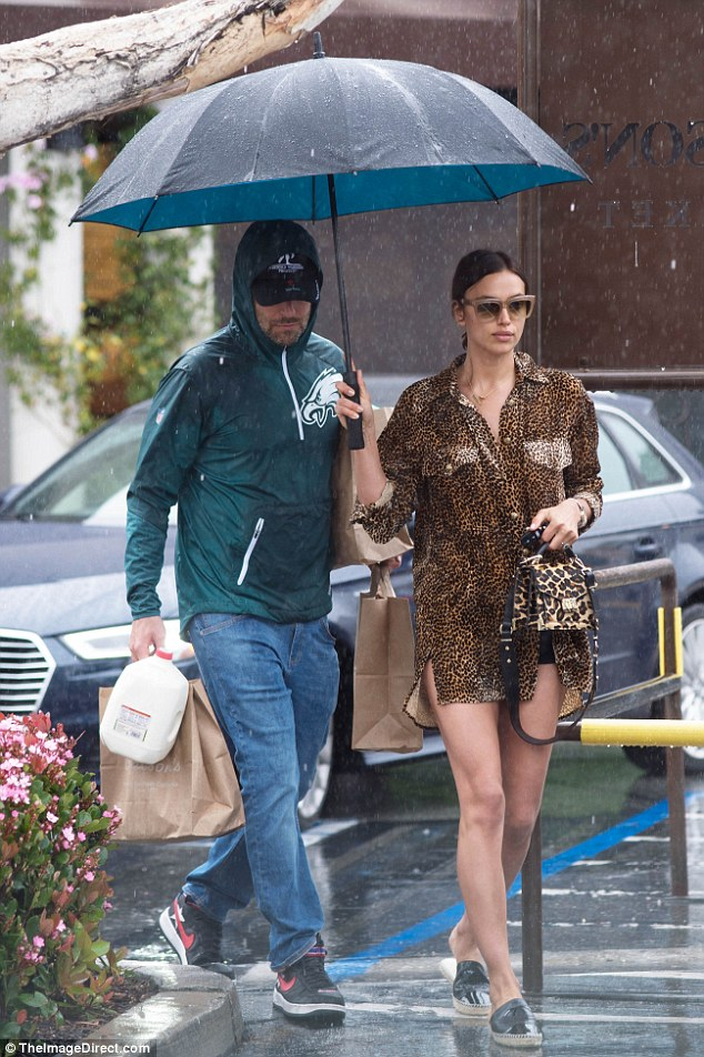 Caught in the rain:Bradley Cooper, 43, and Irina Shayk, 32, went grocery shopping in the pouring rain on Wednesday.