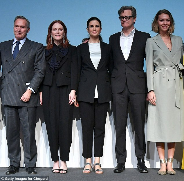 United front:Colin and Livia Firth made their first joint appearance since news of her 11-month affair with the man she later accused of stalking her emerged on Thursday (L-R:Chopard Co-President Karl-Friedrich Scheufele, Julianne Moore, Livia Firth, Colin Firth and Arizona Muse)