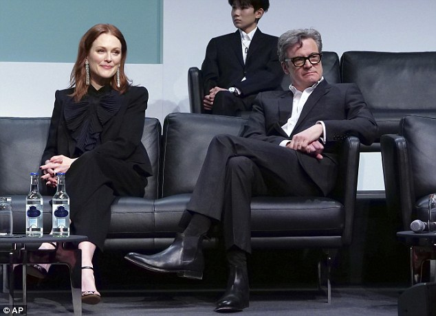 Centre stage:Joining Firth onstage, Julianne Moore looked typically stylish in a smart black ensemble comprised of bow-embellished blouse and tailored trousers