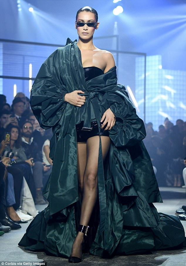 All eyes on her: The 21-year-old model looked incredible in a dramatic ruffled gown