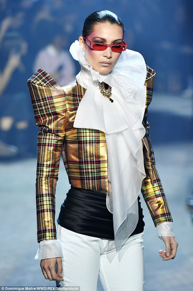 Victoriana: Bella also modeled this eye-catching look consisting of a tartan jacket and ruffled collar