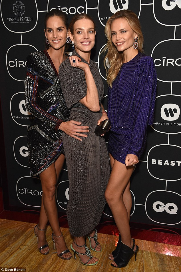 Babe: Izabel looked absolutely beautiful as she scraped her tresses into a high ponytail and she added a pair of spiral earrings to her looks - with Natalia Vodianova and Natasha Poly