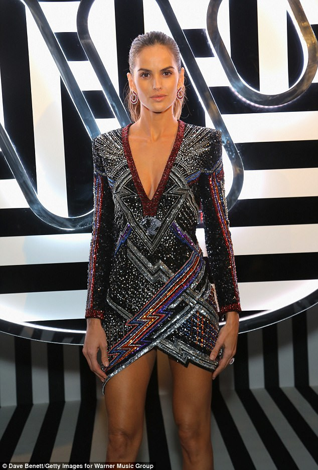 Bombshell: Izabel also rivalled Adwoa on the style front as she showcased her statuesque frame in a figure-hugging mini-dress