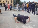 This is the moment a stuntman in Armenia performed 41-push ups in a minute - with the back of his hands flat against the ground