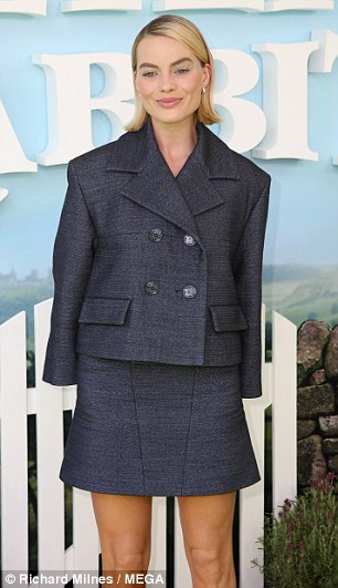 Suits you!Margot wore a double breasted tweed jacket with a matching miniskirt which flaunted her slender frame