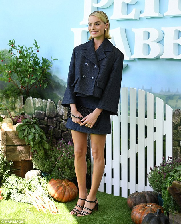 Leggy lady! Margot Robbie flaunts her trim pins and slender frame in a chic tweed suit at Peter Rabbit premiere in Sydney
