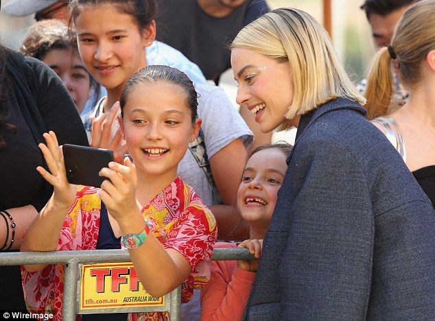 Happy to pose: Margot appeared happy to meet some of her youngest fans