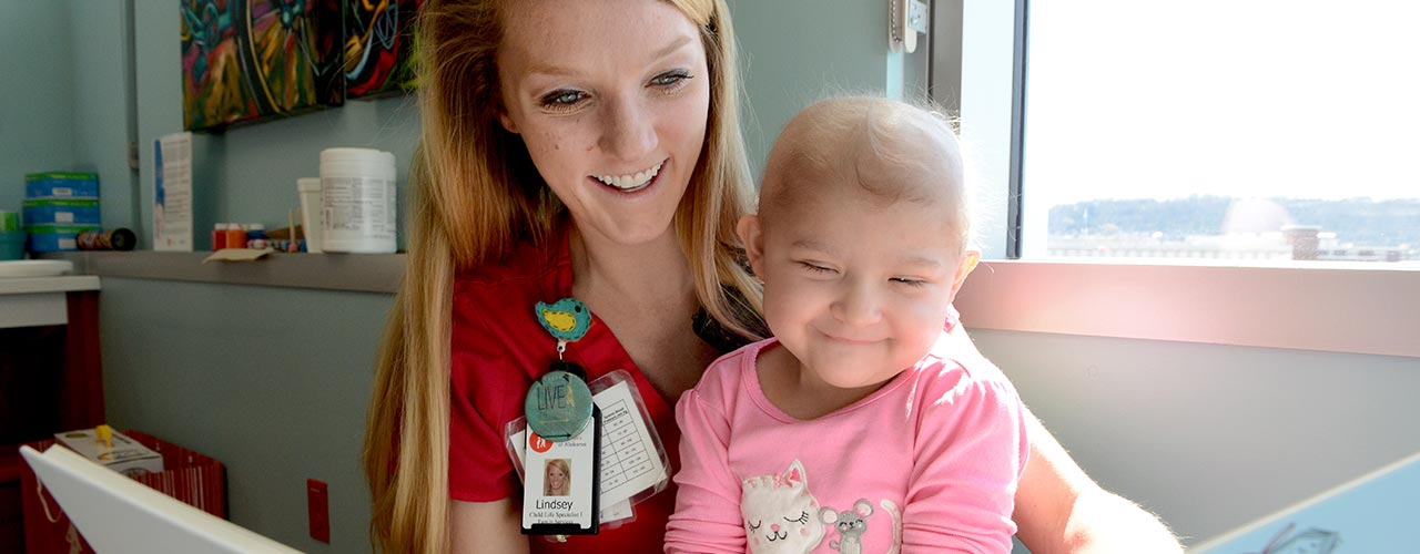 Lindsay Smith reads to a young patient