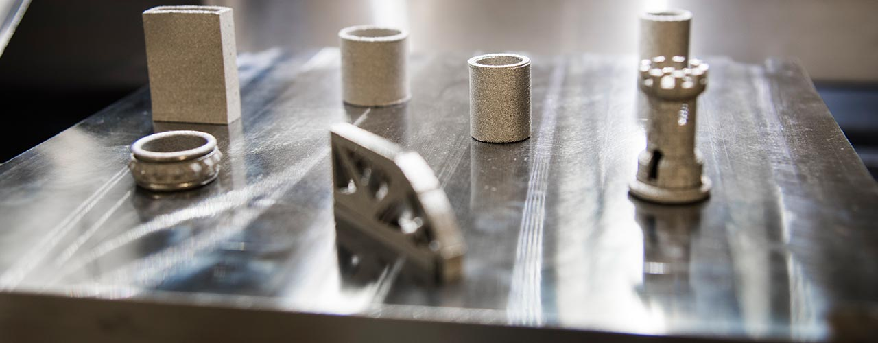 Complex metal parts made using a 3-D printer are shown
