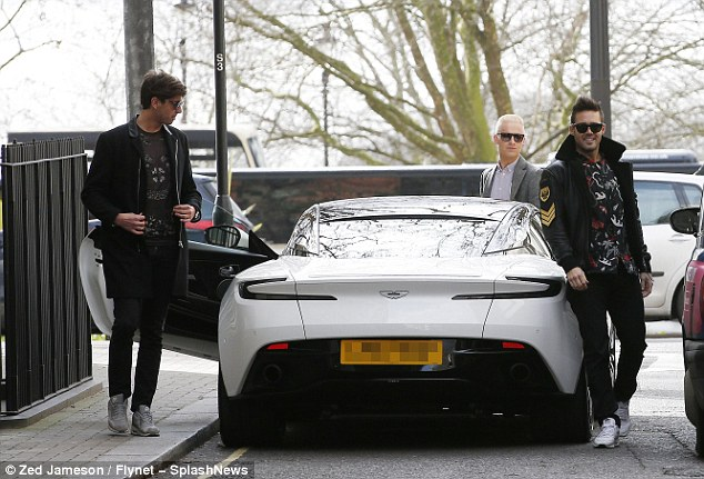 Looking cool: Both Spencer and Ollie were as stylish as ever in printed shirts as they exited the car