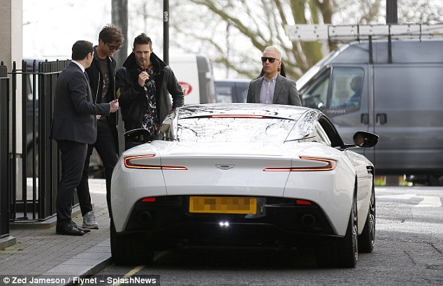 Standout: The car was difficult to miss as it was parked up for collection, with Spencer eagerly picking up the keys