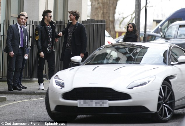 Slick ride: Spencer was joined by his Chelsea pal Ollie Chambers as he picked up the new car in London